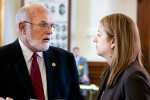 State Sen. Robert Nichols speaks with a staff member in this file photo. (Courtesy Photo)