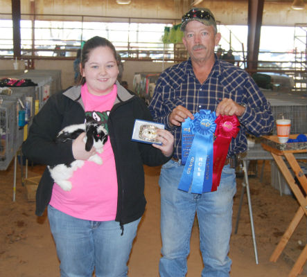 Reserve Grand Champion (Best Opposite) went to Jodi Costlow, 13, of Mabank FFA. She is pictured with her father, Cary.