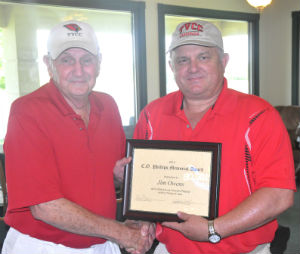 Former Trinity Valley Community College head football coach Jim Owens (left) was presented the 2013 C.O. Phillips Memorial Award Friday, June 7, at the 26th Annual Coaches Playday at Twin Lakes Golf Course. The award is presented each year in memory of former Malakoff Junior High School coach C.O. Phillips, who was an avid golfer and a great ambassador for the game. He died in the summer of 2000. Making the presentation is Benny Rogers, the sports information officer at TVCC, which hosts the tournament each year along with the Athens Daily Review. (COURTESY PHOTO)