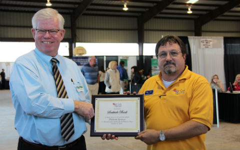 Marty Mullins/Texas Ability LLC (R), CCLACC Chairman of the Board of Directors, presents an appreciation plaque to Ralph Fortner/Southside Bank, $1,500 Platinum underwriting sponsor of the October 17, 2013 Cedar Creek Lake Fall Business Expo at Mabank Pavilion.