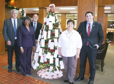 Pictured unveiling the Child Welfare Board Angel Tree are, from left, Henderson County Judge Richard Sanders, Pct. 1 Commissioner Scotty Thomas, Welfare Board member the Rev. Mary Henderson, Welfare Board member Kim Hodges, and Welfare Board Chairman Justin Weiner.