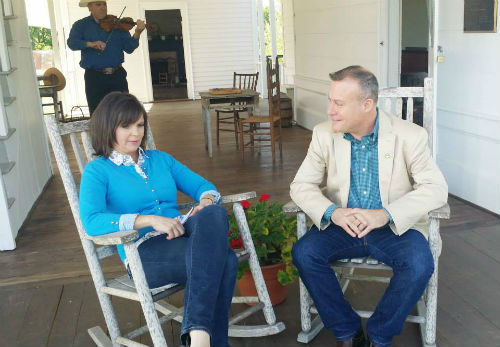 WFAA's Paige McCoy Smith talks to Athens Mayor Jerry Don Vaught on the porch of the Wofford House at the Arboretum Wednesday, April 23.