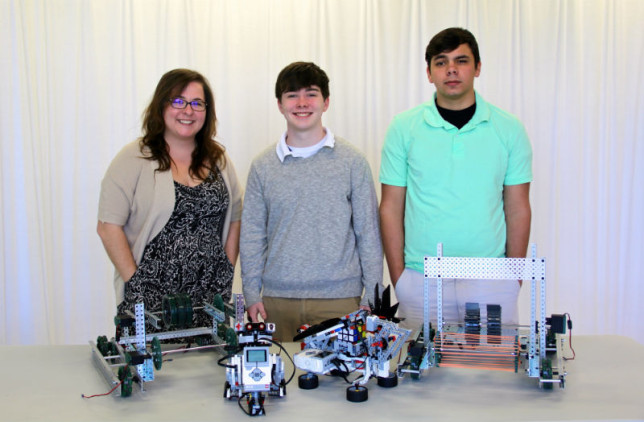 Thanks to a grant by the Athens Public Education Foundation, AHS teacher Julie Whitley was able to start a robotics class in January. Students are preparing for competitions in which robots they build and program will perform tasks. Also pictured are robotics team members John Baldwin (center) and Dakota Stone. (Toni Garrard Clay/AISD)
